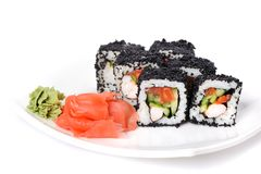 Japan black tobiko rolls with cream cheese and salmon served wit Stock Photography