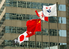 Japan, Canadian and Chinese flags Stock Images
