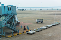 Japan - Circa 2014: Landing Airplanes, Waiting For Takeoff Permission Aircrafts On Runway, Loading And Unloading Luggage At Narit Royalty Free Stock Image