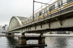 Japan City Train running on the Bridge over  Sumida River royalty free stock images
