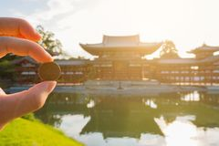 Japan commemorates its longevity and cultural significance by displaying its image on the 10 yen coin. Byodo-in (Phoenix Hall) Japan commemorates its longevity royalty free stock image