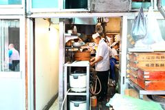 Japan: Cook in the kitchen. Chefs preparing food in the kitchen of a restaurant at Tsukiji Seafood Fish Market stock photography