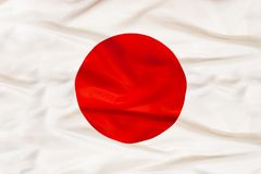 Japan national flag with waving fabric royalty free stock photos