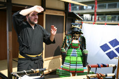 Japan day. DUSSELDORF, GERMANY - MAY 17: unknown young man of Samurai group Takeda explaining the history of the samurai tradition on the 13th Japan Celebration Royalty Free Stock Images