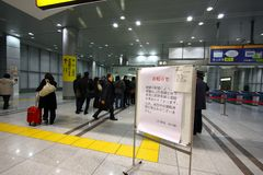 Japan Earthquake 2011. Passengers cannot take the train, Because All train canceled on 11 March 2011 Stock Photo