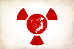 Japan earthquake and radioactivity. Japan earthquake, tsunami and nuclear tragedy illustration, 11th March 2011. Red japan flag circle with white Japan map and vector illustration
