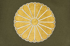 Japan Emblem. Golden embroidery of Japan coat of arms on gray fabric with vector format available royalty free illustration