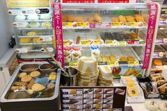 Japan fast food. TOKYO, JAPAN - DECEMBER 2, 2016: Typical Japanese convenience store fast food set in Tokyo. Nikuman steamed buns, oden broth winter foods and Royalty Free Stock Photo