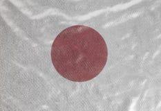 Japan flag background. Japan flag on fabric background close up royalty free stock image