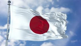Japan Flag in a Blue Sky. Use this clip loud and proud to express loyalty and love to our country. It is a seamless loop with luma channel royalty free stock image