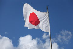 Japan flag, blue sky. Flag of Japan,  Japanese flag. Japanese culture Royalty Free Stock Photos