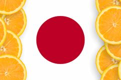 Japan flag in citrus fruit slices vertical frame. Japan flag in vertical frame of orange citrus fruit slices. Concept of growing as well as import and export of royalty free stock photo