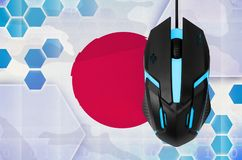 Japan flag and computer mouse. Concept of country representing e-sports team. Japan flag and modern backlit computer mouse. Concept of country representing e royalty free stock photos