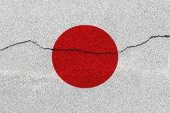 Japan flag on concrete wall with crack. Patriotic grunge background. National flag of Japan royalty free stock images