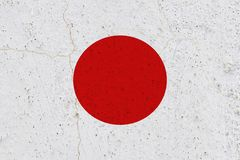 Japan flag on concrete wall. Patriotic grunge background. National flag of Japan royalty free stock photography