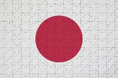 Japan flag is depicted on a folded puzzle royalty free stock image