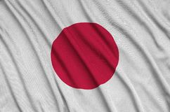 Japan flag is depicted on a sports cloth fabric with many folds. Sport team banner. Japan flag is depicted on a sports cloth fabric with many folds. Sport team stock photography