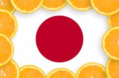 Japan flag in fresh citrus fruit slices frame. Japan flag in frame of orange citrus fruit slices. Concept of growing as well as import and export of citrus royalty free illustration