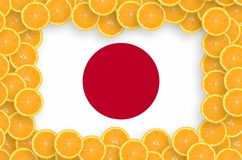 Japan flag in fresh citrus fruit slices frame. Japan flag in frame of orange citrus fruit slices. Concept of growing as well as import and export of citrus stock illustration
