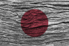 Japan flag with high detail of old wooden background . Royalty Free Stock Photos