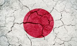 Japan flag. On dry earth ground texture background royalty free stock photography
