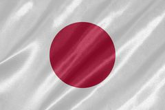 Japan Flag. With waving on satin texture royalty free illustration