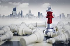 Japan flag near fallen white chess pieces Royalty Free Stock Photo