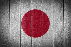 Japan Flag. Painted on old wood plank background stock photography