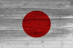 Japan flag painted on old wood plank. Patriotic background. National flag of Japan royalty free stock photo