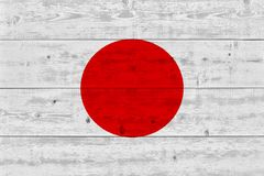 Japan flag painted on old wood plank. Patriotic background. National flag of Japan stock photo