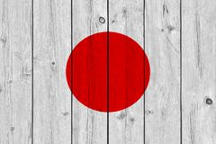 Japan flag painted on old wood plank. Patriotic background. National flag of Japan stock photography
