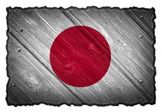 Japan Flag. Painted on wood tag. Isolated on white background stock image