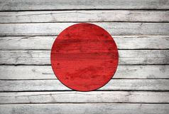 Japan flag painted on wooden boards. Grunge style royalty free illustration