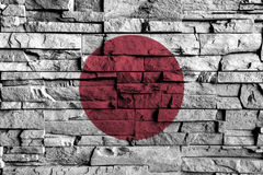 Japan flag painting on high detail of old brick wall Royalty Free Stock Photos