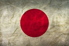 Japan Flag on Paper. Flag on an old Paper Texture Royalty Free Stock Image