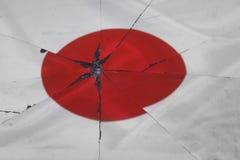 Japan flag is reflected in broken mirror. Still life stock image