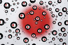 Japan flag. Reflection of Japan flag in water droplets Royalty Free Stock Image