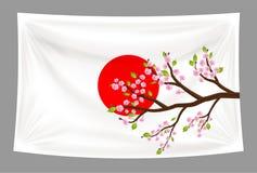 Japan flag with sakura cherry blossom branch Royalty Free Stock Photography