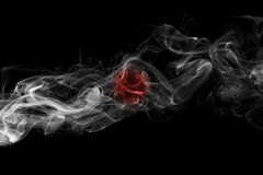 Japan flag smoke. Isolated on a black background stock photography