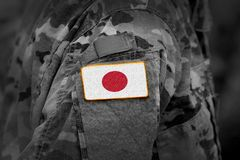Japan flag on soldiers arm collage.  stock photography