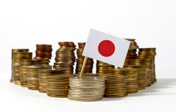 Japan flag with stack of money coins. Japan flag waving with stack of money coins Stock Photos
