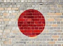 Japan flagga på en tegelstenvägg Fotografering för Bildbyråer