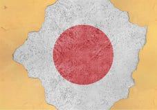 Japan flaggaabstrakt begrepp i betong för agg för fasadstruktur stor skadad royaltyfri foto