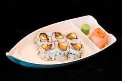 Japan food maki on boat. Close up view of japan food arrangement Royalty Free Stock Image