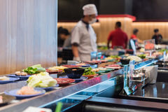 Japan food restaurant belt buffet and chef Stock Photography