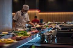 Japan food restaurant belt buffet and chef Stock Photos