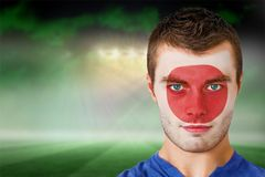 Japan football fan in face paint Stock Photos