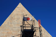 Japan founds helping Italian Archeology. Japanese Flag on Piramide Cestia in Rome, Italy.The restoration is sponsored by a Japanese businessman Royalty Free Stock Photos