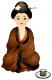 Japan girl sitting near the cup of tea Stock Photos