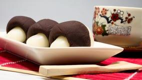 Japan& x27; gnocchi della luna di autunno di s e tè giapponese Fotografia Stock